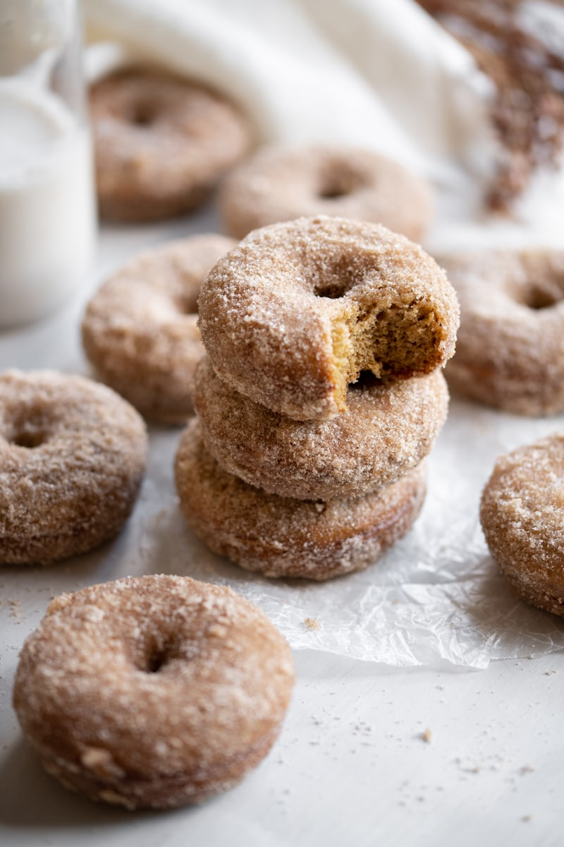 stacked apple cider donuts on wax paper