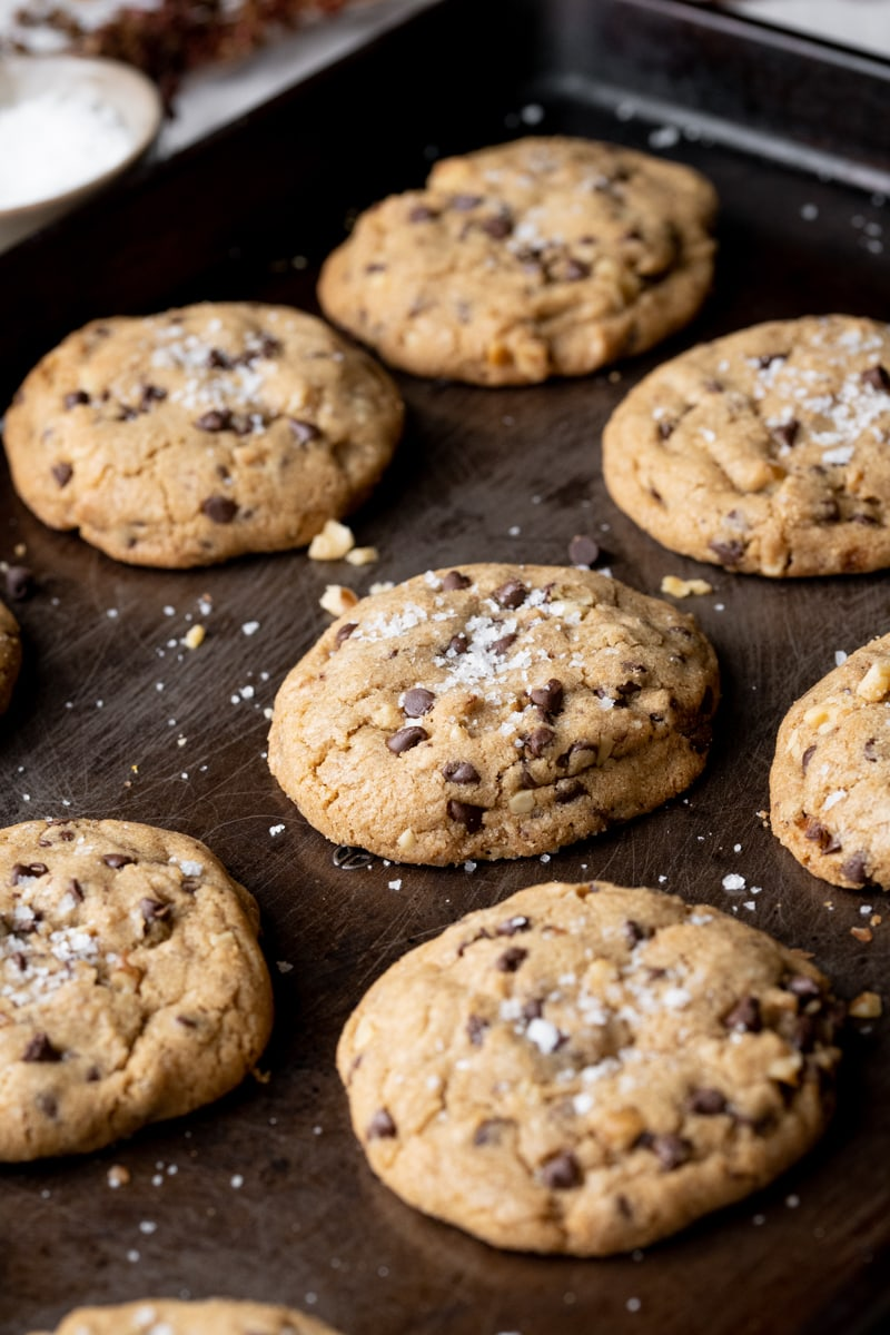 chocolate chip cookies layed out on a brown baking pan