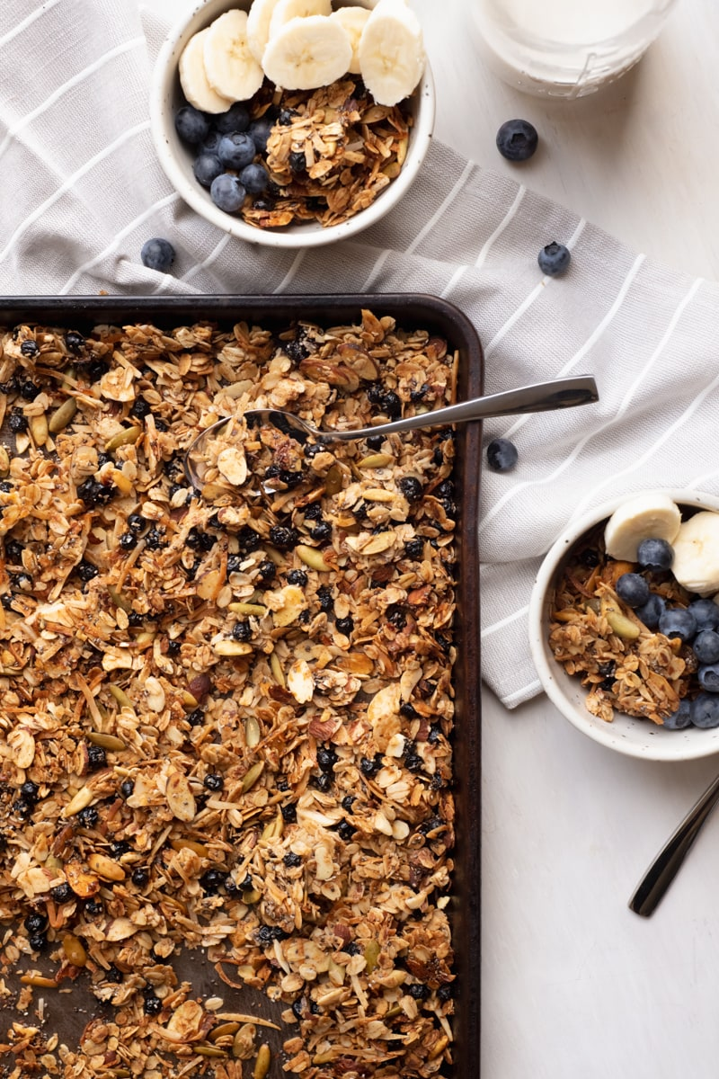 blueberry granola on a baking sheet