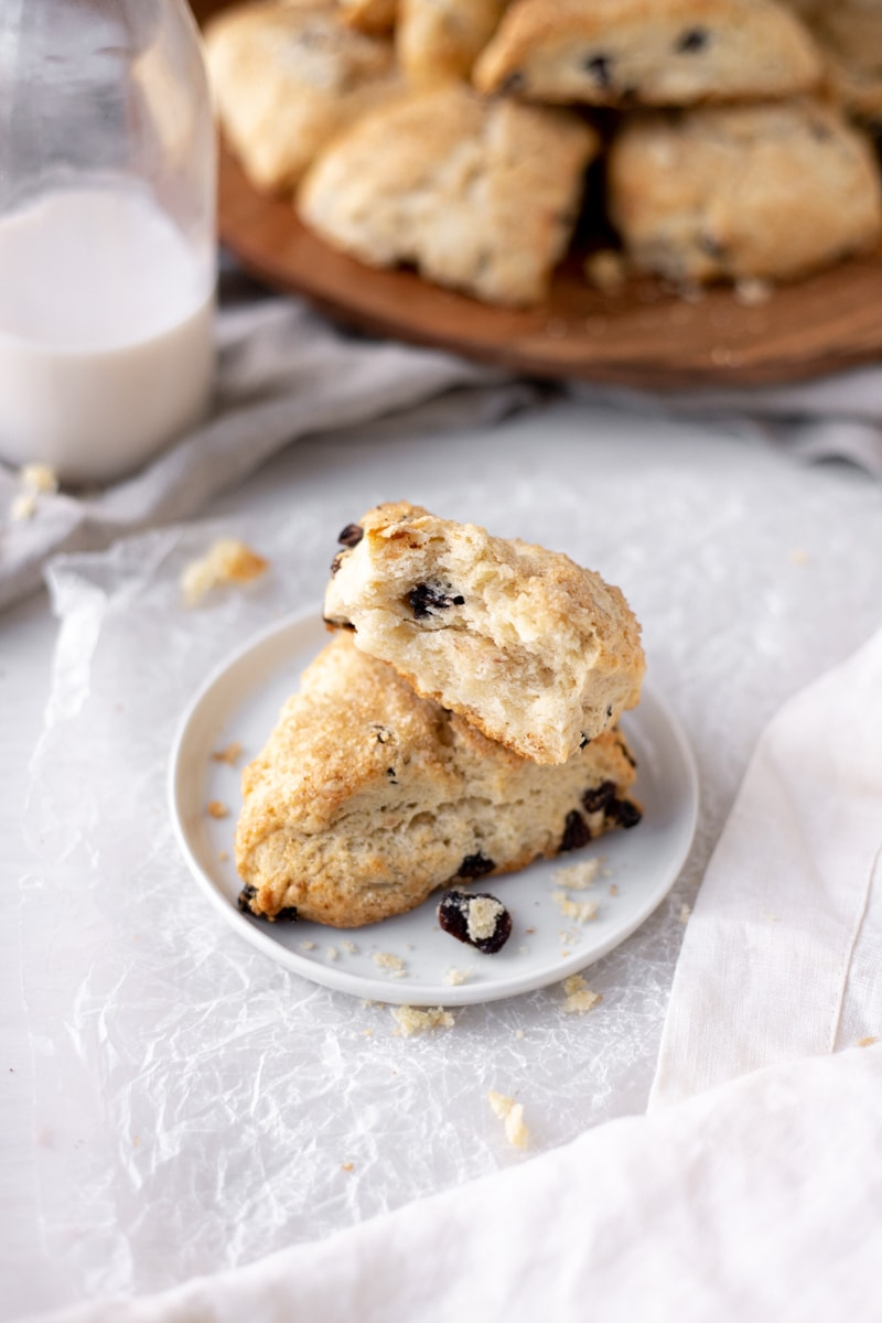 stacked cherry vanilla scones on a white plate