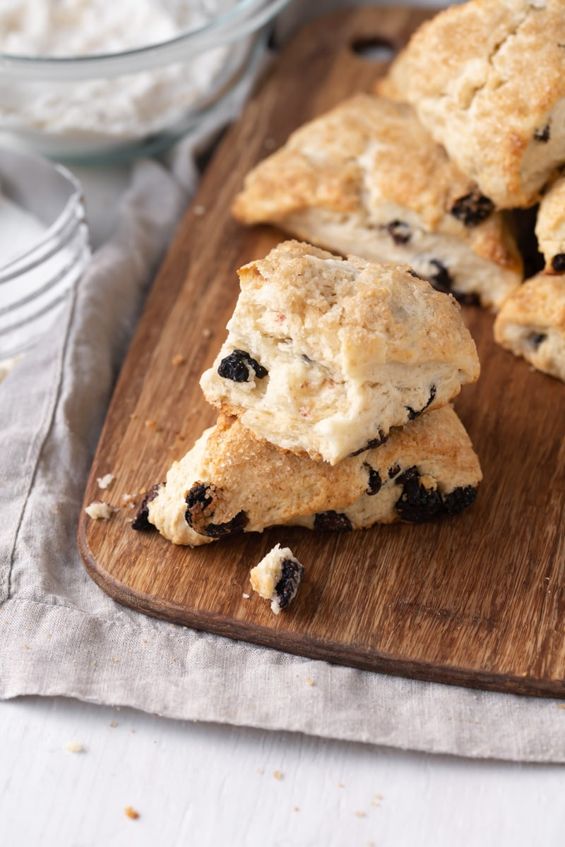 stacked cherry vanilla scones on a wooden cutting board