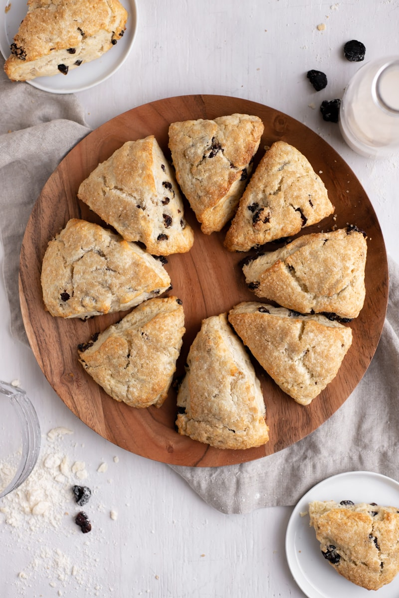 circle of cherry vanilla scones on a wooden plate