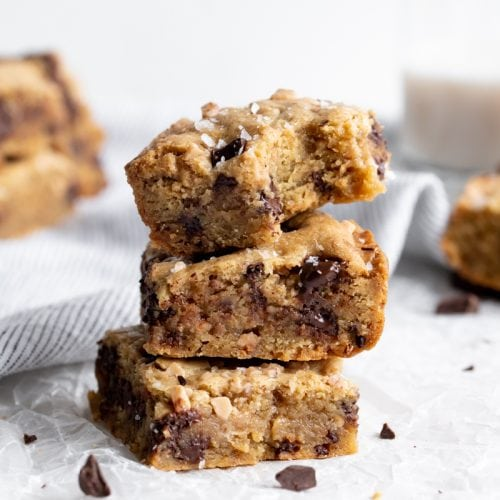 stacked salted toffee blondies on wax paper